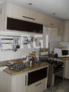 Casa Em Condominio de 5 dormitórios em Jardim Carvalho, Porto Alegre - RS