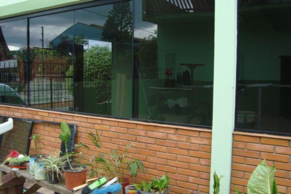 Casa de 3 dormitórios em Parque Santa Fé, Porto Alegre - RS
