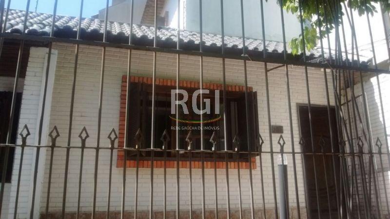 Casa de 5 dormitórios em Auxiliadora, Porto Alegre - RS