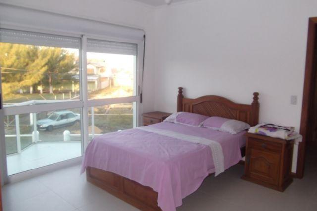 Casa de 4 dormitórios em Centro, Atlântida - RS