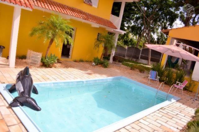 Casa de 4 dormitórios em Vila Nova, Porto Alegre - RS